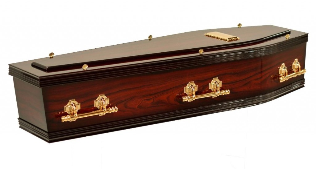 The Two Tone Coffin, as seen in Stan Crapp Funerals Kiama, comes with these features: Includes six swing round bar handles in chrome or gold Light Rosewood stain with black edging Interior lined with swansdown edged with a gold trim Example shown: Hi Gloss